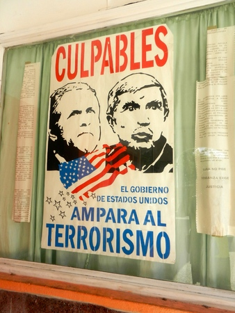 Poster accusing government of United States of supporting terrorists
