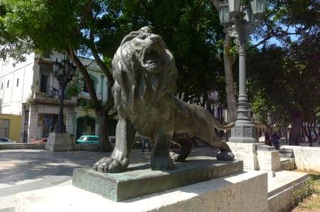 Bronze statue of roaring lion along Prado Promenade in Havana