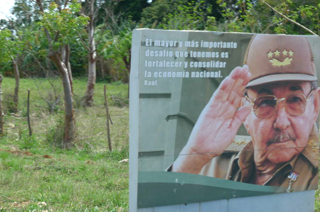 "Billboard showing Raúl Castro saluting, with the slogan ""The biggest and most important challenge that we have is to strengthen and consolidate the national economy"""