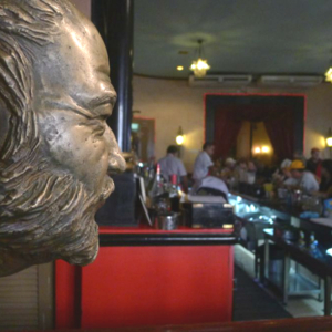 A statue of Ernest Hemingway looks out over the counter at La Floridita, a popular bar in Havana